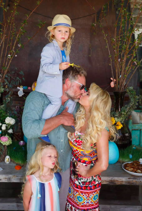 """<p>""""Family love"""" was the theme of this snap, taken during their Easter celebration. Jess was kissing her husband of two years as their Maxi made a kiss face and Ace looked too cool for school on the former football player's shoulders. (Photo: Jessica Simpson via <a rel=""""nofollow"""" href=""""https://www.instagram.com/p/BTALAPvArI4/"""">Instagram</a>) </p>"""