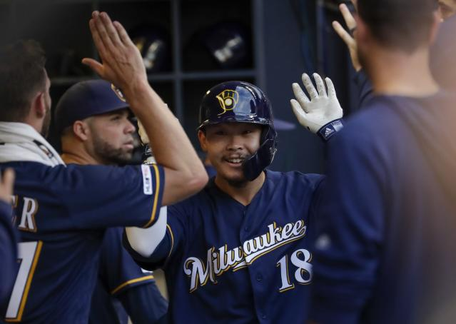 Milwaukee Brewers' Keston Hiura is congratulated after hitting a home run during the third inning of a baseball game against the Texas Rangers Saturday, Aug. 10, 2019, in Milwaukee. (AP Photo/Morry Gash)