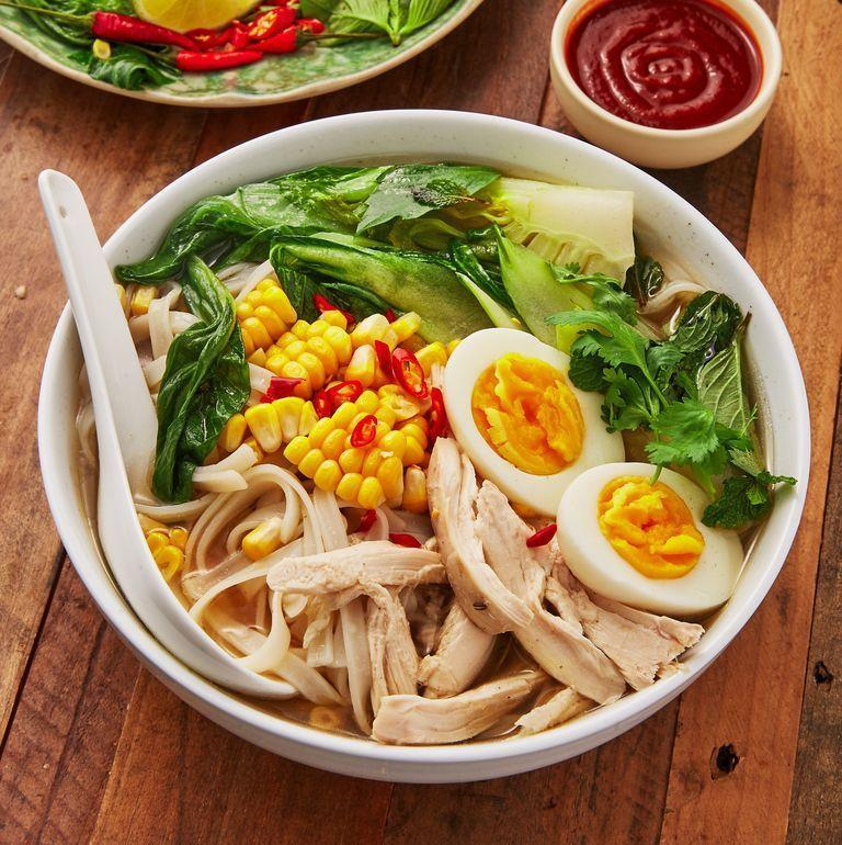 """<p>We love <a href=""""https://www.delish.com/uk/cooking/recipes/a30293330/pho-recipe/"""" rel=""""nofollow noopener"""" target=""""_blank"""" data-ylk=""""slk:pho"""" class=""""link rapid-noclick-resp"""">pho</a>, who doesn't? And this <a href=""""https://www.delish.com/uk/chicken-recipes/"""" rel=""""nofollow noopener"""" target=""""_blank"""" data-ylk=""""slk:chicken"""" class=""""link rapid-noclick-resp"""">chicken</a> alternative is insanely delicious. Featuring the usual ingredients including ginger, star anise and cinnamon, along with a <a href=""""https://www.delish.com/uk/cooking/recipes/a30440664/slow-cooker-rotisserie-chicken-recipe/"""" rel=""""nofollow noopener"""" target=""""_blank"""" data-ylk=""""slk:whole chicken"""" class=""""link rapid-noclick-resp"""">whole chicken</a> (yum!) and chilli, this recipe is SO flavourful. </p><p>Get the <a href=""""https://www.delish.com/uk/cooking/recipes/a30607809/chicken-broth/"""" rel=""""nofollow noopener"""" target=""""_blank"""" data-ylk=""""slk:Chicken Broth With Noodles"""" class=""""link rapid-noclick-resp"""">Chicken Broth With Noodles</a> recipe.</p>"""
