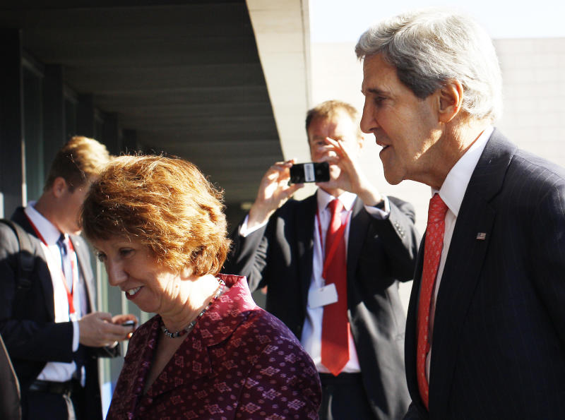 U.S. Secretary of State John Kerry, right, and European Union Foreign Policy Chief Catherine Ashton walks after arriving for an informal meeting of EU ministers for Foreign Affairs at the National Art Gallery in Vilnius, Lithuania, Saturday, Sept. 7, 2013. Kerry is in Europe courting international support for a possible U.S. strike on the Syrian regime for its alleged use of chemical weapons. (AP Photo/Mindaugas Kulbis)