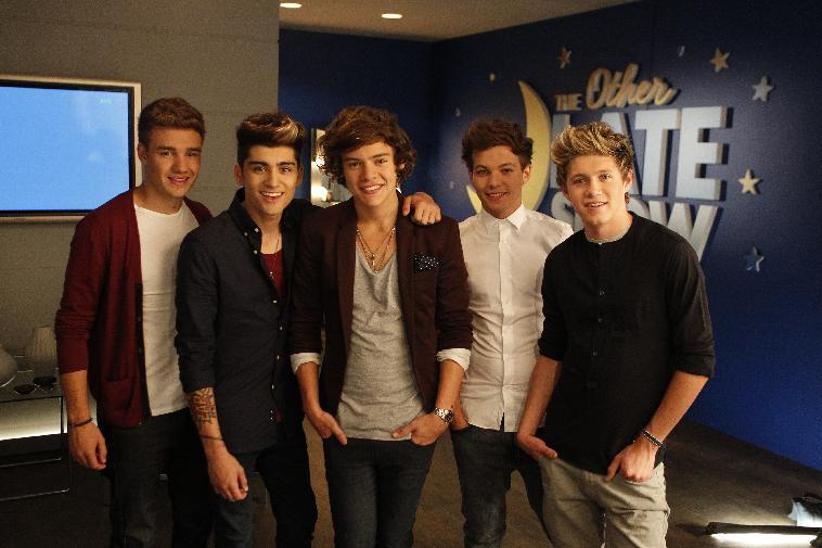 "This Sept. 2, 2012 photo shows the music group One Direction, from left, Liam Payne, Zayn Malik, Harry Styles, Louis Tomlinson and Niall Horan during the taping of a Pepsi commercial in New Orleans. The soda company is partnering with the boy band and New Orleans Saints quarterback Drew Brees for an ad that will debut Wednesday. It's part of Pepsi's ""Live for Now"" campaign, which has also featured Nicki Minaj and Katy Perry. (Photo by William Haber/Invision/AP)"