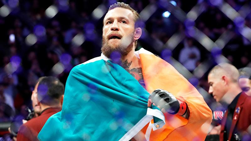 Conor McGregor (pictured) holds the Irish flag after a fight.