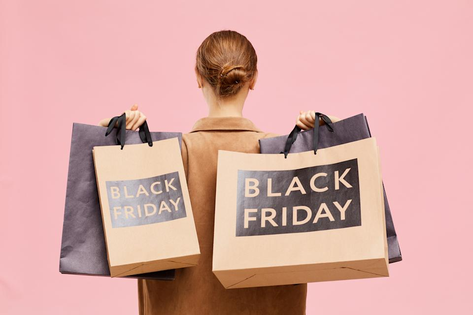 Carrying black Friday paperbags