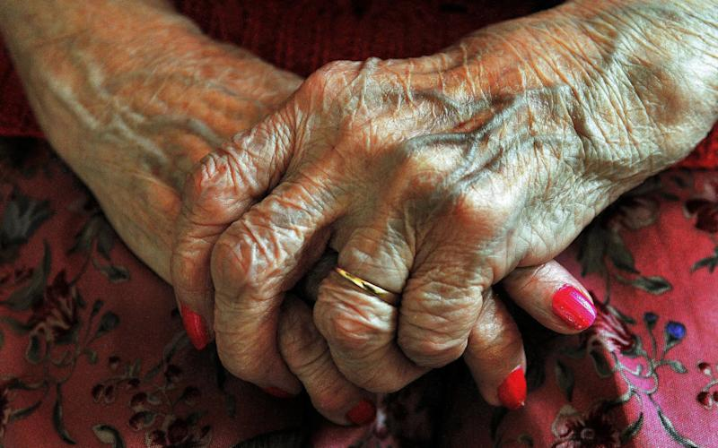 the hands of an elderly woman - John Stillwell/PA
