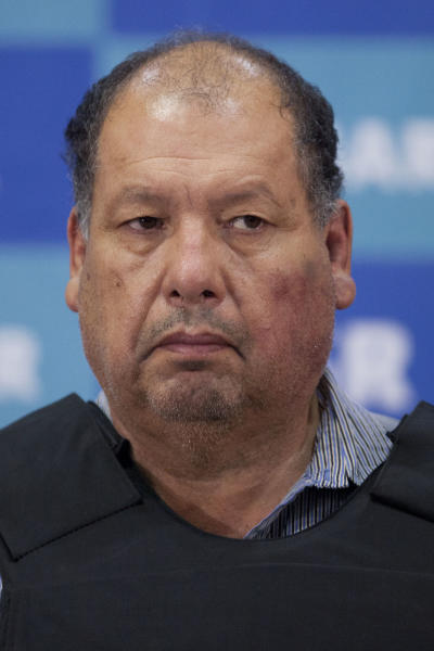 """Mario Cardenas Guillen, also known as """"El Gordo"""" and """"M-1,"""" stands facing journalists during his media presentation in Mexico City, Tuesday, Sept. 4, 2012. Authorities says Cardenas Guillen, a top leader of the Gulf drug cartel, is the brother of Osiel Cardenas Guillen, who led the cartel until he was detained in 2003. Osiel Cardenas was extradited in 2007 to the United States and sentenced to 25 years in prison. (AP Photo/Alexandre Meneghini)"""
