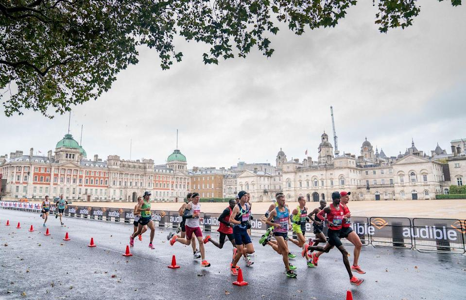<p>Mo Farah leads the British runners group as the Elite Men's Race passes Horse Guards Parade</p>