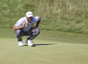 United States' Dustin Johnson lines up his putt on the 6th green during the third round of the British Open Golf Championship at Royal St George's golf course Sandwich, England, Saturday, July 17, 2021. (AP Photo/Ian Walton)