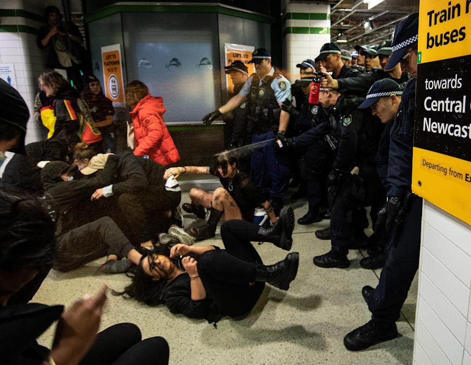 Police shown spraying protesters with pepper spray inside Central Station on Saturday. Source: AAP
