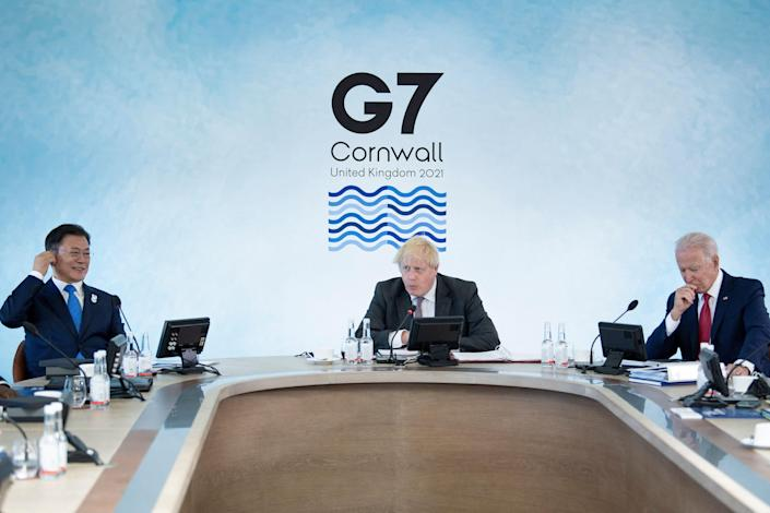 Three G7 leaders sit at table