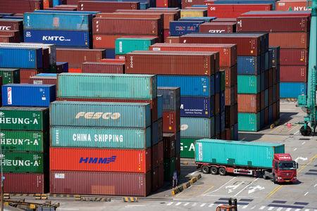 Shipping containers are seen at the port in Shanghai