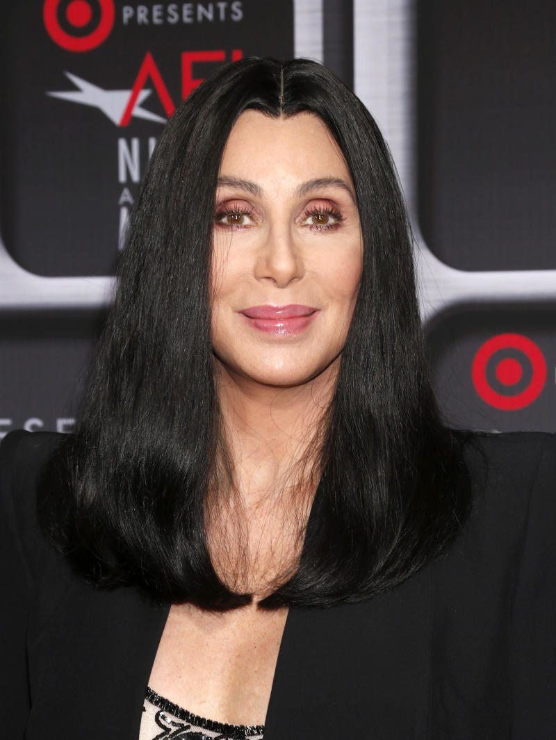 """FILE - This April 24, 2013 file photo shows performer Cher at the AFI Night at the Movies at the ArcLight in Los Angeles. Cher will be performing on the singing competition series """"The Voice"""" during the season finale on Tuesday, June 18. She will perform """"Woman's World"""" the first single off of her upcoming album. (Photo by Todd Williamson/Invision/AP, file)"""