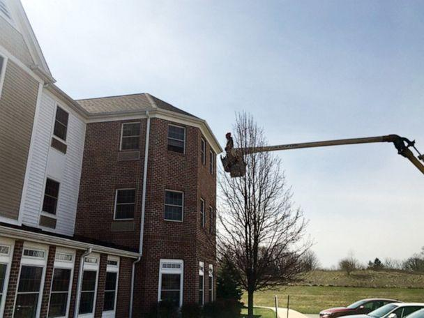 PHOTO: Charley Adams, 45, uses his company's bucket truck to visit his 80-year-old mother quarantined on the 3rd floor of a nursing home in New Middletown, Ohio, March 22, 2020. (Courtesy Charley Adams)