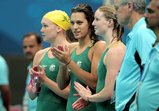 DELHI, INDIA - OCTOBER 06: Kylie Palmer, Blair Evans and Bronte Barratt of Australia celebrate finishing the Women's 4x200m Freestyle Final in first place and win the gold medal at the Dr. S.P. Mukherjee Aquatics Complex during day three of the Delhi 2010 Commonwealth Games on October 6, 2010 in Delhi, India. (Photo by Adam Pretty/Getty Images)