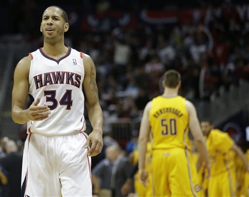 Atlanta Hawks point guard Devin Harris (34) reacts in the closing moments during the second half of an NBA first-round playoff basketball game against the Indiana Pacers, in Atlanta, Friday, May 3, 2013. Indiana won 81-73. (AP Photo/John Bazemore)