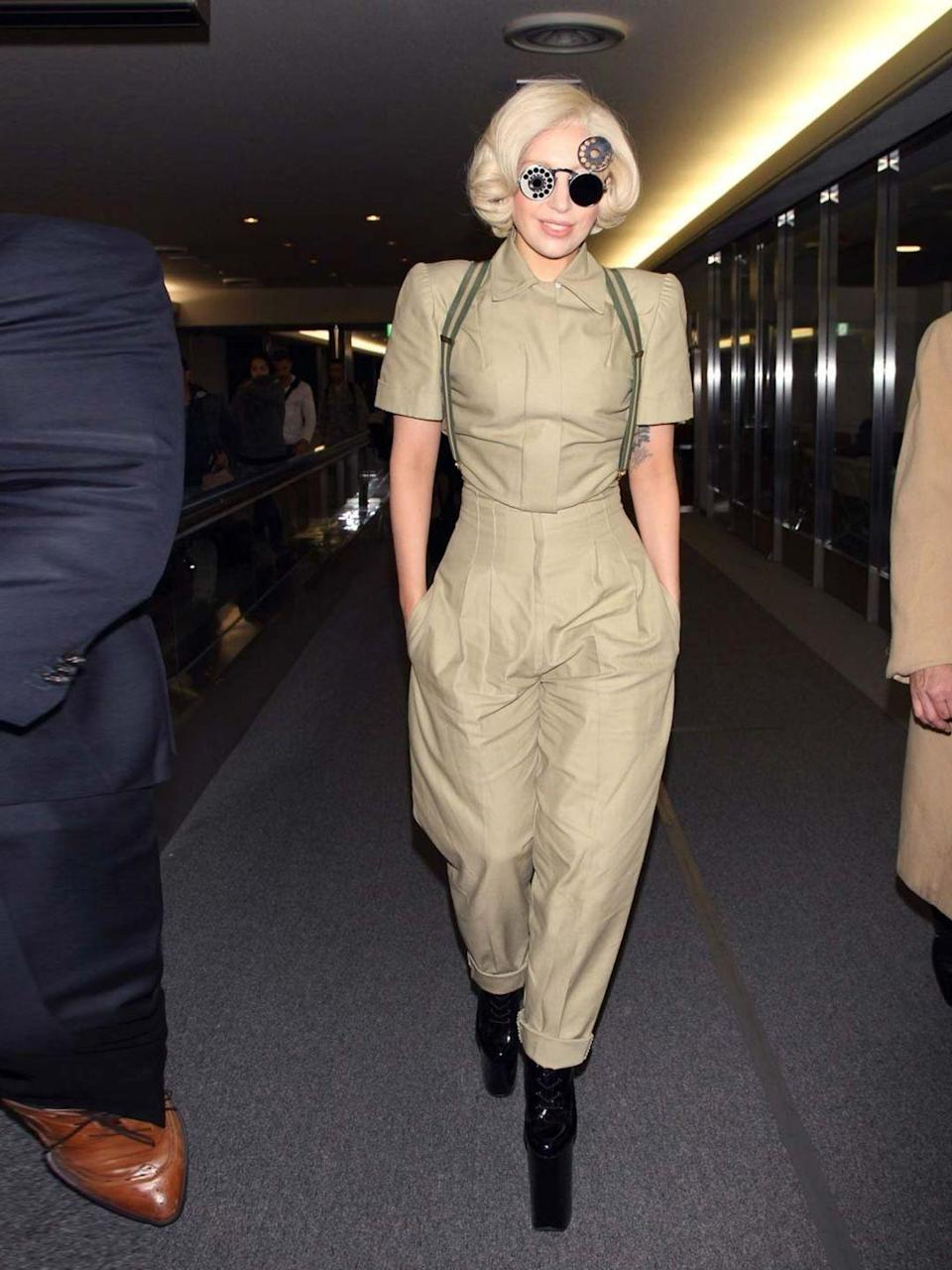 <p>Lady Gaga arrives in Japan to promote her new album Artpop in a khaki jumpsuit, November 2013.</p>