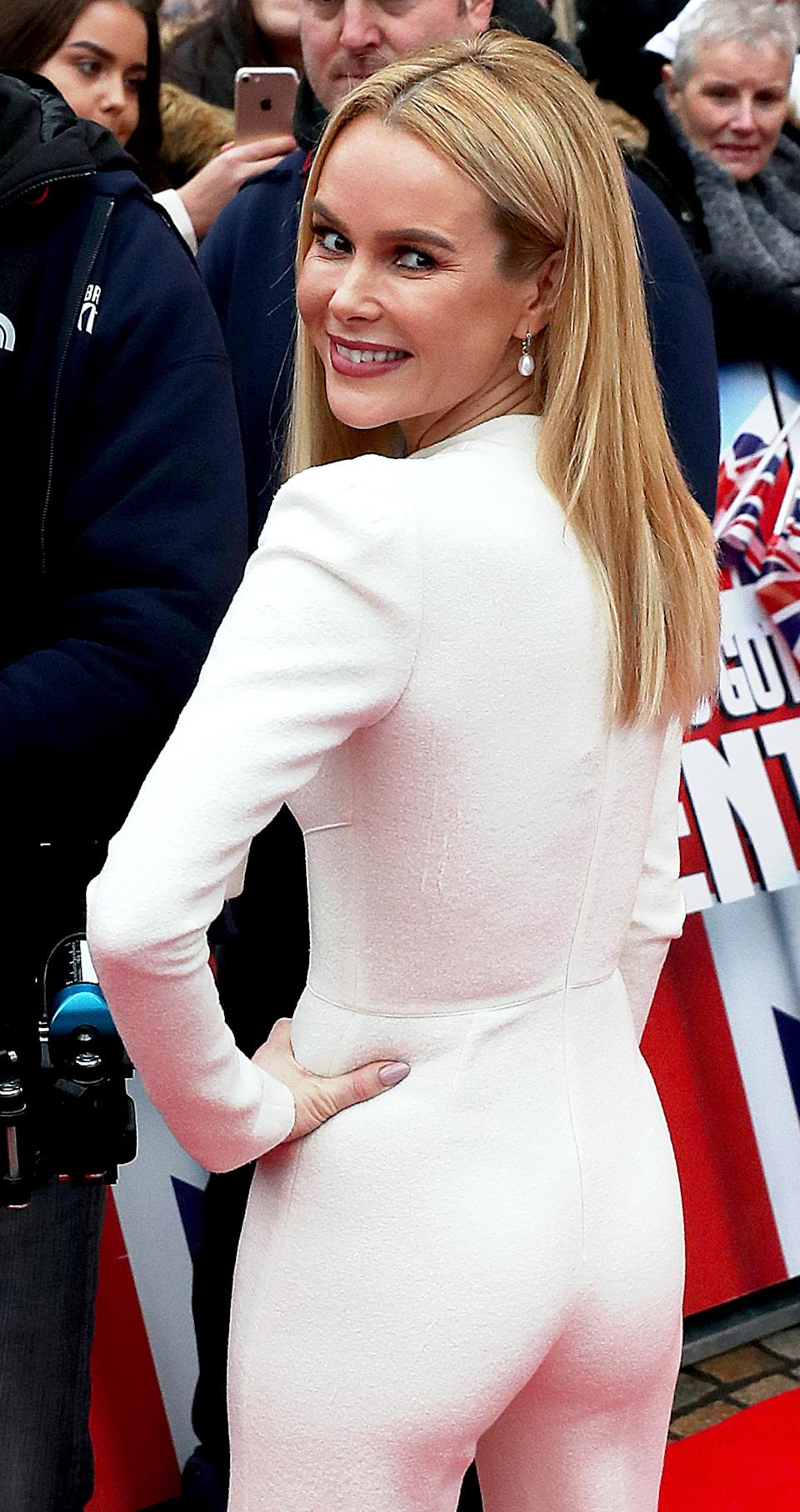 """Embargoed to 0001 Monday August 19 File photo dated 18/01/17 of Amanda Holden who has won the Rear Of The Year Award, leaving competition from """"fake"""" bottoms behind."""