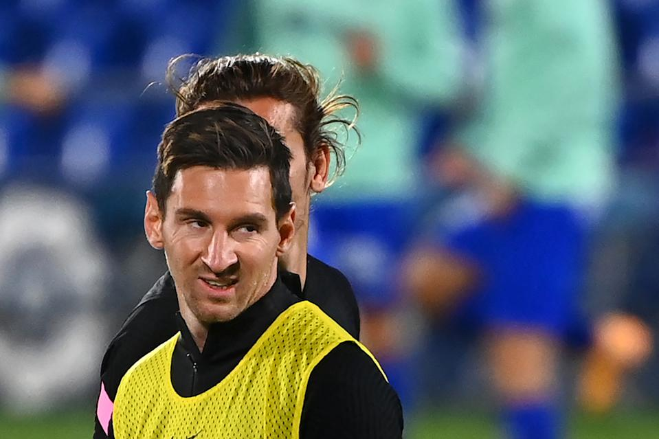 Barcelona's Argentine forward Lionel Messi and Barcelona's French midfielder Antoine Griezmann (BEHIND) warm up before the Spanish League football match between Getafe and Barcelona at the Coliseum Alfonso Perez stadium in Getafe, south of Madrid, on October 17, 2020. (Photo by GABRIEL BOUYS / AFP) (Photo by GABRIEL BOUYS/AFP via Getty Images)