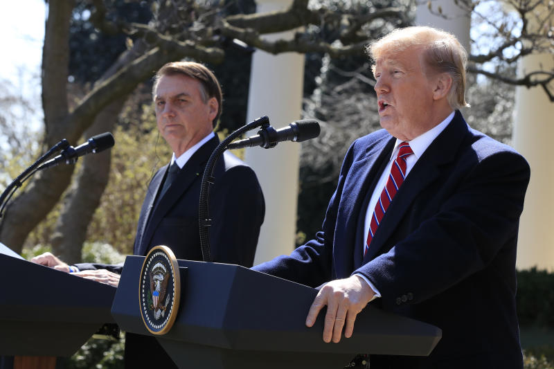 President Donald Trump and visiting Brazilian President Jair Bolsonaro speak during a news conference in the Rose Garden of the White House, Tuesday, March 19, 2019, in Washington. (AP Photo/Manuel Balce Ceneta)