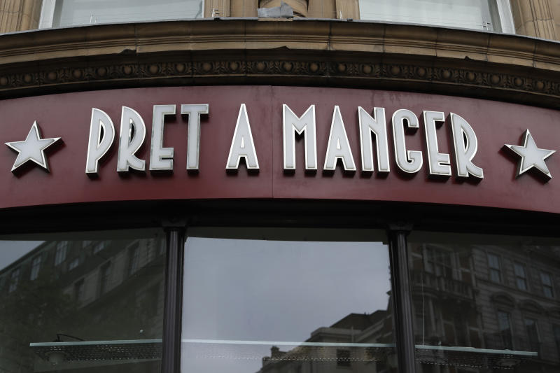 A view of a window and logo of a Pret A Manger, in London, Tuesday, May 29, 2018. The British Sandwich shop chain is being taken over by German controlled investment group JAB Holding Company in a deal worth more that 1.5 billion pounds sterling. (AP Photo/Matt Dunham)