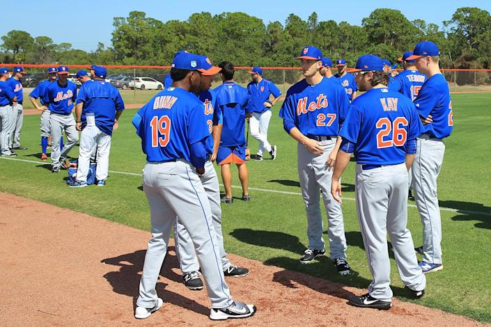 <p>New York Mets prospects get reacquainted on the field before stretching during STEP Camp at New York Mets spring training facility in Port St. Lucie, Fla., Sunday, Feb. 26, 2017. (Gordon Donovan/Yahoo Sports) </p>