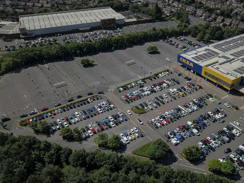 Aerial view of shoppers waiting to get inside the Wednesbury Ikea which has opened today for the first time since it closed due to the Coronavirus lockdown. (SWNS)