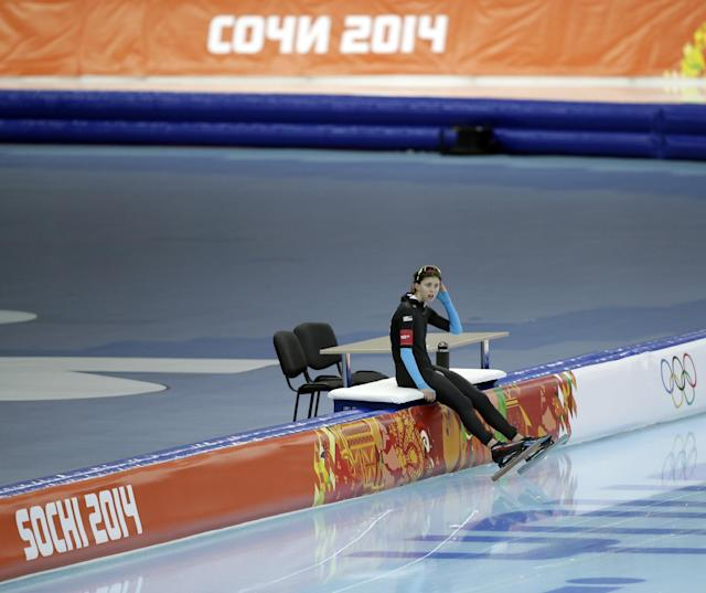 Maria Lamb of the U.S. rests after competing in the women's 5,000-meter speedskating race at the Adler Arena Skating Center during the 2014 Winter Olympics in Sochi, Russia, Wednesday, Feb. 19, 2014. (AP Photo/Patrick Semansky)