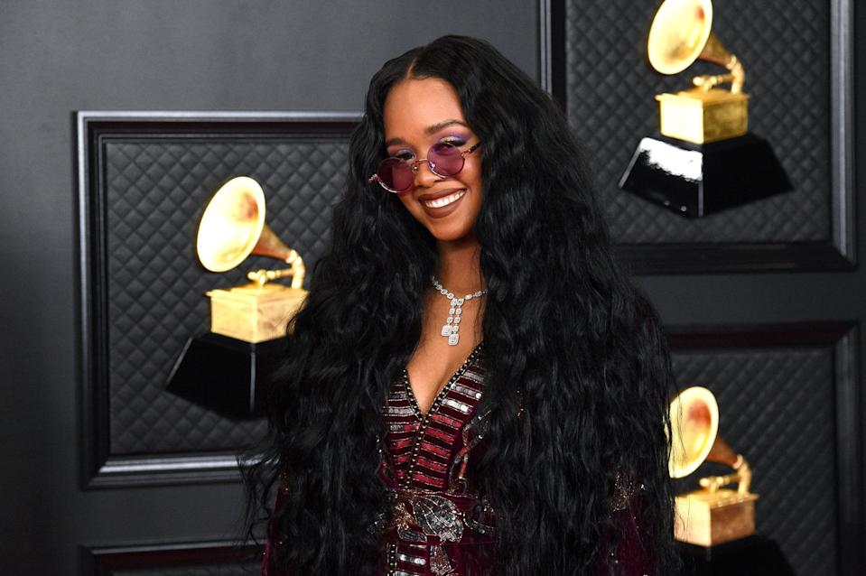 LOS ANGELES, CALIFORNIA - MARCH 14: H.E.R. attends the 63rd Annual GRAMMY Awards at Los Angeles Convention Center on March 14, 2021 in Los Angeles, California. (Photo by Kevin Mazur/Getty Images for The Recording Academy )