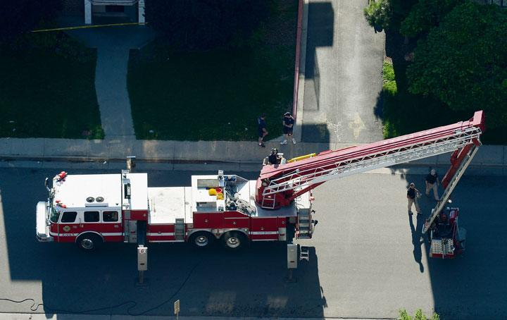 AURORA, CO - JULY 21:  Seen from the air, a fire truck stands by at the booby-trapped apartment of suspect James Holmes after he went on a shooting rampage at nearby Century 16 movie theatre during an early morning screening of the new Batman movie, 'The Dark Knight Rises,' on July 21, 2012 in Aurora, Colorado. According to reports, 12 people have been killed and over 59 injured including 9 in critical condition. Police have the suspect, twenty-four year old James Holmes of North Aurora, in custody.