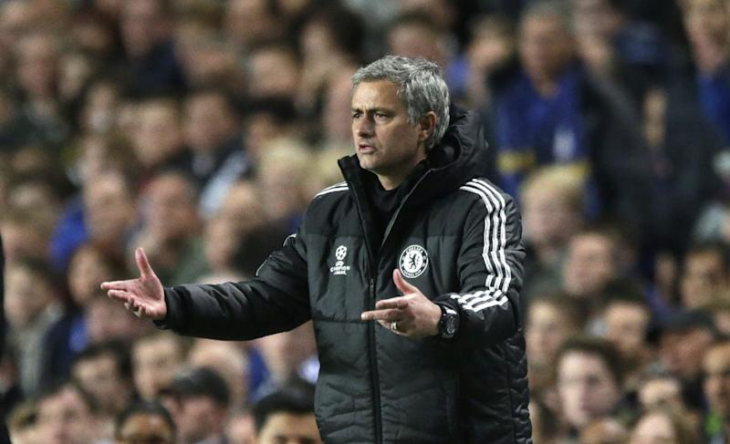 Chelsea's manager Jose Mourinho gestures to his team from the technical area during the Champions League semifinal second leg soccer match between Chelsea and Atletico Madrid at Stamford Bridge stadium in London, Wednesday, April 30, 2014