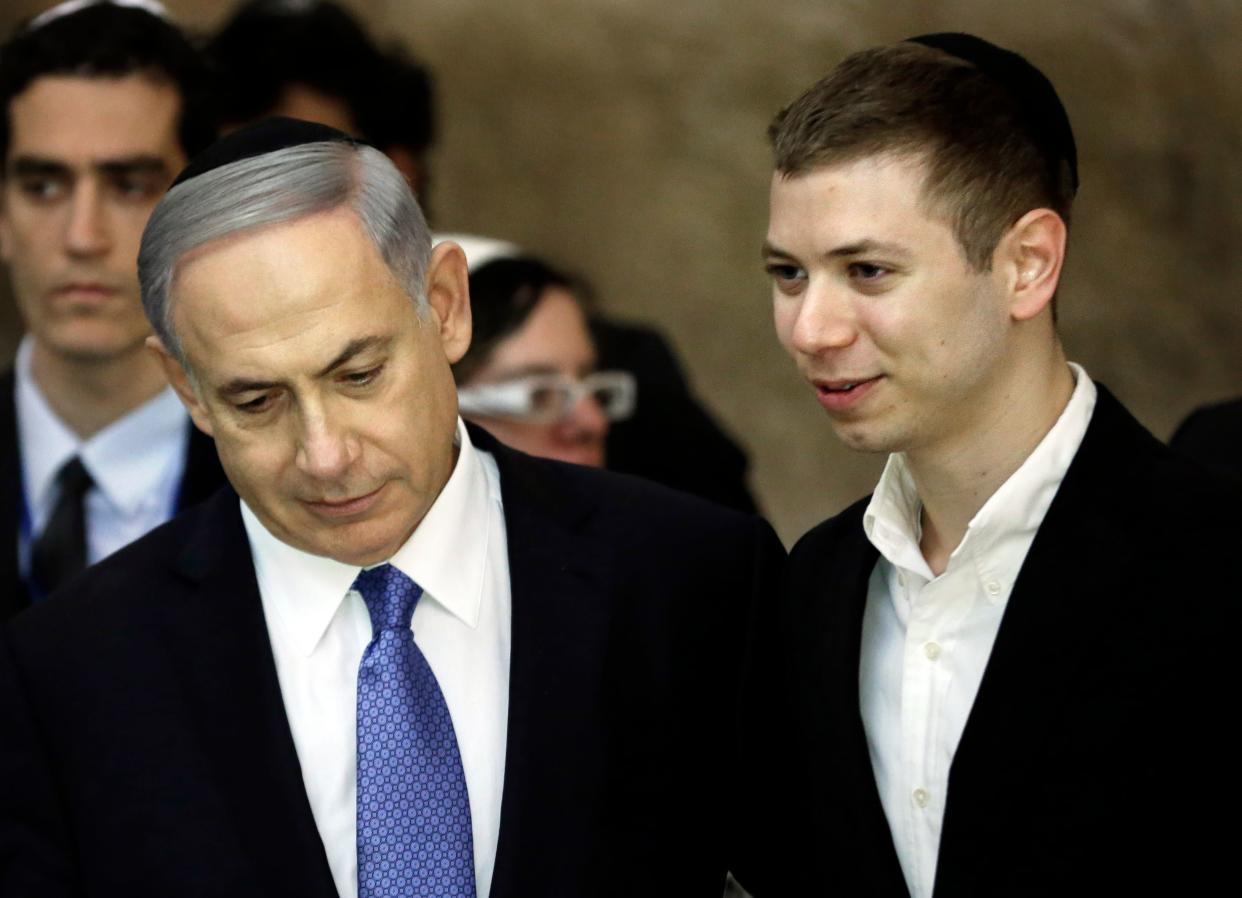 Prime Minister Benjamin Netanyahu, left, and his son Yair visiting the Western Wall in Jerusalem on March 18, 2015. The younger Netanyahu faced online criticism on Sept. 9, 2017, after sharing an image on his Facebook page deemed anti-Semitic by critics. (Photo: Thomas Coex/AFP/Getty Images)