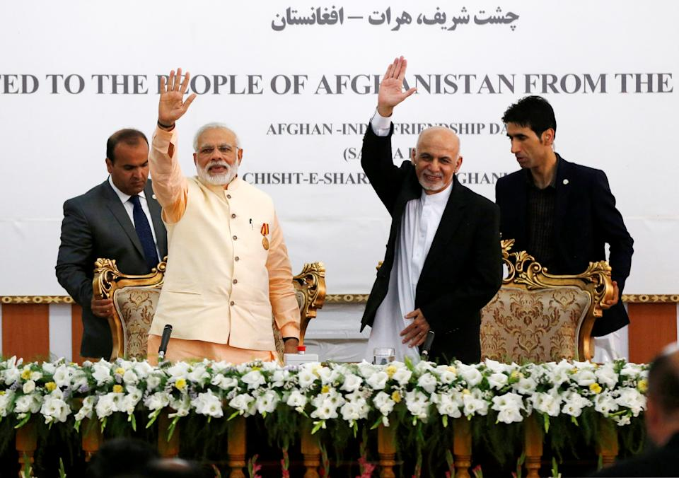 India's Prime Minister Narendra Modi (L) and Afghanistan's president Ashraf Ghani wave after the inauguration of the Salma Dam in Herat province, Afghanistan June 4, 2016. REUTERS/Omar Sobhani