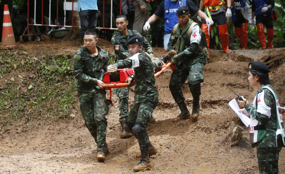 Thai soldiers hold an evacuation drill near the Tham Luang Nang Non cave in Mae Sai, Chiang Rai province, in northern Thailand Saturday, June 30, 2018. Rescuers have been searching for 12 boys and their soccer coach missing for seven days in the flooded cave complex. (AP Photo/Sakchai Lalit)