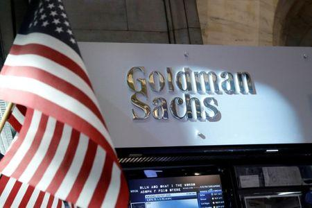 FILE PHOTO - A view of the Goldman Sachs stall on the floor of the New York Stock Exchange in New York, U.S. on July 16, 2013. REUTERS/Brendan McDermid/File Photo