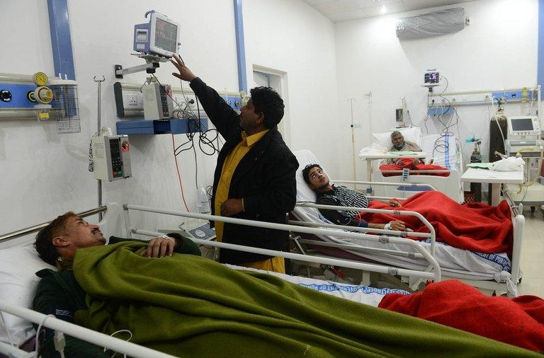 Patients who consumed toxic cough syrup receive treatment in a hospital in Gujranwala on December 29, 2012