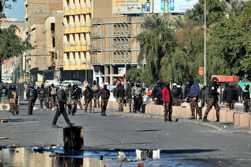Security forces try to disperse anti-government protesters during clashes in Baghdad, Iraq, Sunday, Jan. 26, 2020. (AP Photo/Hadi Mizban)