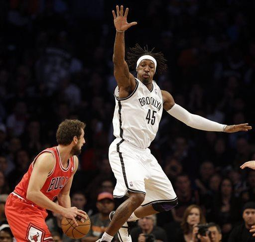 Brooklyn Nets forward Gerald Wallace (45) pressures Chicago Bulls guard Marco Belinelli during the first half in Game 7 of their first-round NBA basketball playoff series in New York, Saturday, May 4, 2013. (AP Photo/Julio Cortez)