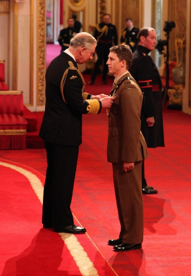 Mr Cutterham is presented with the Conspicuous Gallantry Cross