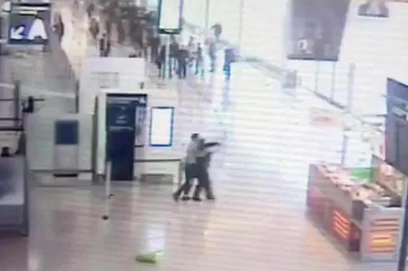 Attack: a gunman at Orly airport in Paris grabs a soldier from behind: AP