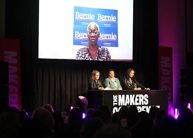 (L-R) Katie Couric, Editor-in-Chief of HuffPost Lydia Polgreen and National Politics Reporter of Yahoo News Brittany Shepherd, with Nina Turner onscreen, speak onstage during the 2020 MAKERS Conference at the InterContinental Los Angeles Downtown on February 10, 2020 in Los Angeles, Calif. (Photo by Rachel Murray/Getty Images for MAKERS)