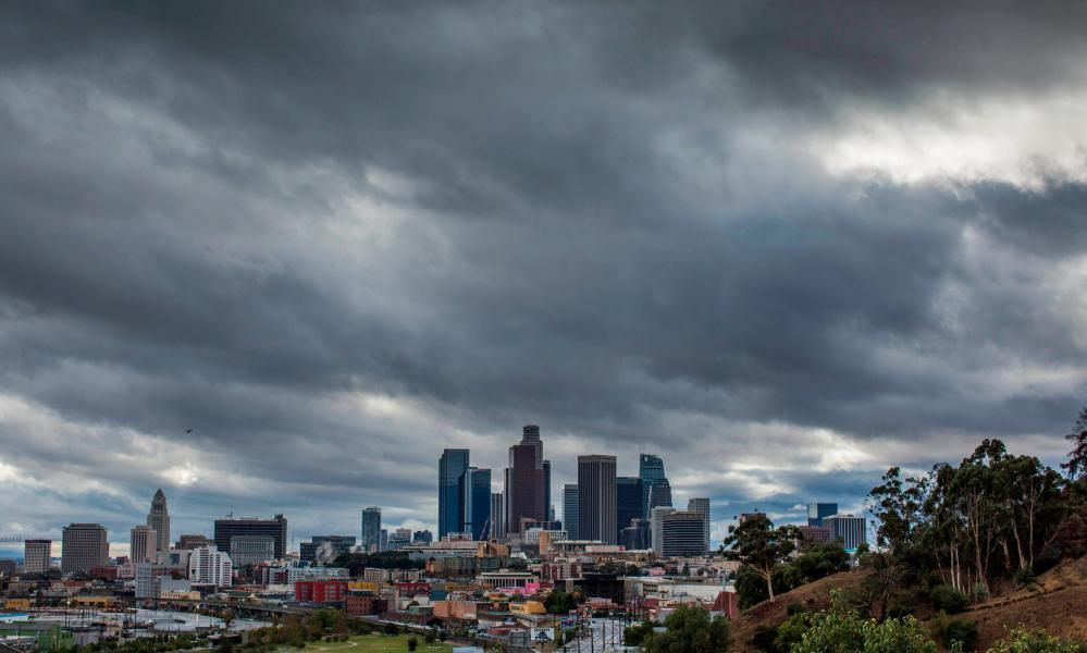 "<span class=""element-image__caption"">Heavy clouds above downtown Los Angeles on Thanksgiving Day.</span> <span class=""element-image__credit"">Photograph: Apu Gomes/AFP via Getty Images</span>"