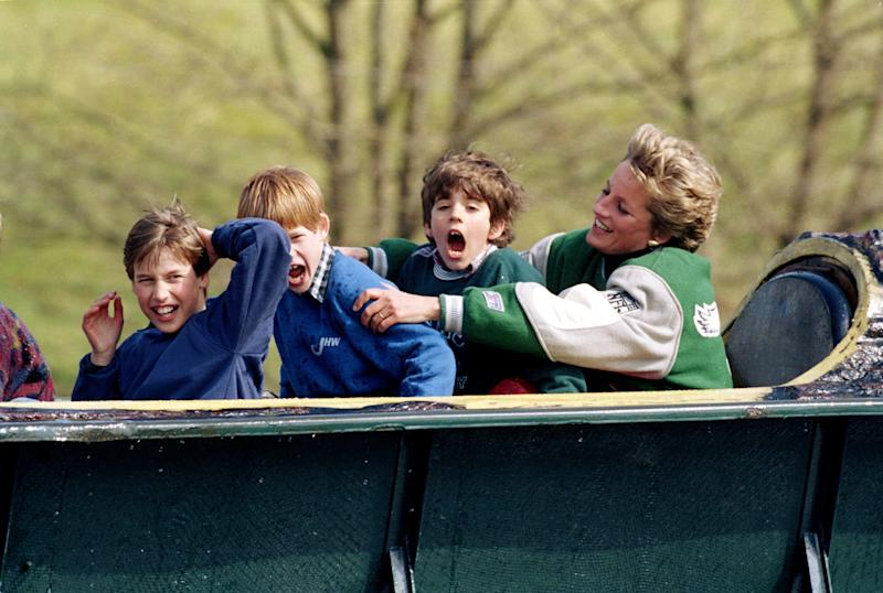 Princess Diana with Prince William (left), Prince Harry and a friend at an amusement park in 1994. (Julian Parker via Getty Images)