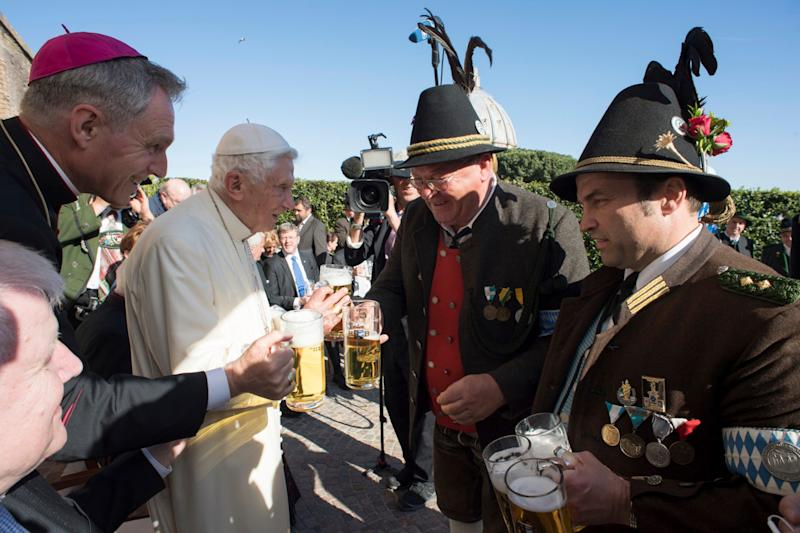 Pope Emeritus Benedict XVI toasts his 90th birthday  - Credit: AP