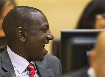 Kenya's Deputy President William Ruto reacts in the courtroom before trial at the International Criminal Court in The Hague