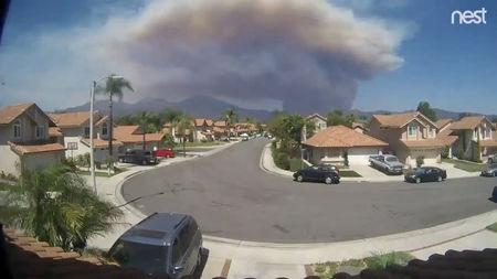 FILE PHOTO: A still frame taken from a timelapse video sourced from social media dated August 6, 2018 shows the Holy Fire as seen from Rancho Santa Magarita, California, U.S. ARTHUR WHITING/via REUTERS