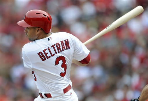 St. Louis Cardinals' Carlos Beltran hits his second home run of a baseball game during the fourth against the Washington Nationals Sunday, Sept. 30, 2012, in St. Louis. (AP Photo/Bill Boyce)