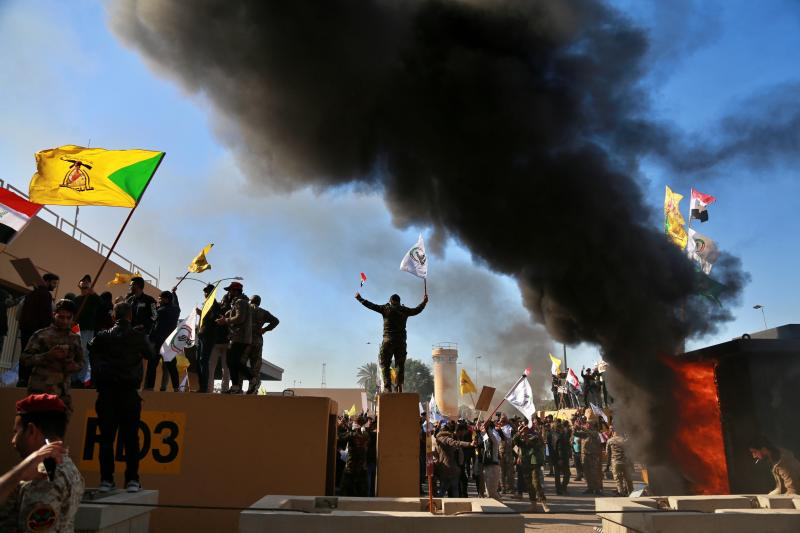 Protesters burn property in front of the U.S. embassy compound, in Baghdad, Iraq, Tuesday, Dec. 31, 2019. (Photo: Khalid Mohammed/AP)