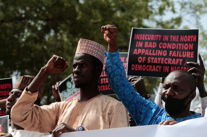 Demonstrators gesture as they gather to urge authorities to rescue hundreds of abducted schoolboys, in northwestern state of Katsina