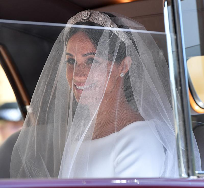 WINDSOR, UNITED KINGDOM - MAY 19: (EMBARGOED FOR PUBLICATION IN UK NEWSPAPERS UNTIL 24 HOURS AFTER CREATE DATE AND TIME) Meghan Markle arrives at St George's Chapel, Windsor Castle for her wedding to Prince Harry on May 19, 2018 in Windsor, England. Prince Henry Charles Albert David of Wales marries Ms. Meghan Markle in a service at St George's Chapel inside the grounds of Windsor Castle. Among the guests were 2200 members of the public, the royal family and Ms. Markle's Mother Doria Ragland. (Photo by Pool/Max Mumby/Getty Images)