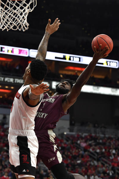 Eastern Kentucky forward Darius Hicks (5), right, shoots over Louisville forward Malik Williams (5) during the first half of an NCAA college basketball game in Louisville, Ky., Saturday, Dec. 14, 2019. (AP Photo/Timothy D. Easley)