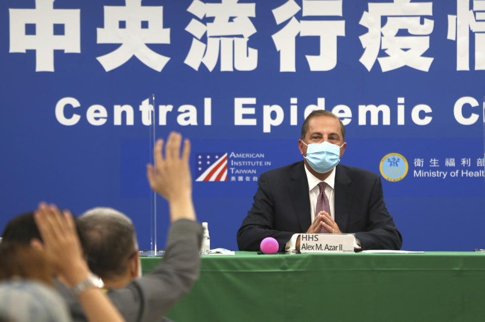 U.S. Health and Human Services Secretary Alex Azar takes questions from the press at the Central Epidemic Command Center in Taipei, Taiwan, Monday, Aug. 10, 2020. Azar arrived in Taiwan on Sunday in the highest-level visit by an American Cabinet official since the break in formal diplomatic relations between Washington and Taipei in 1979. (AP Photo/Chiang Ying-ying)